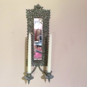 Antique wall sconce with candles
